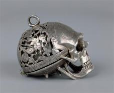 A skull. A watch. A beautiful piece of seventeenth-century jewelry from Switzerland. Now in the Louvre.